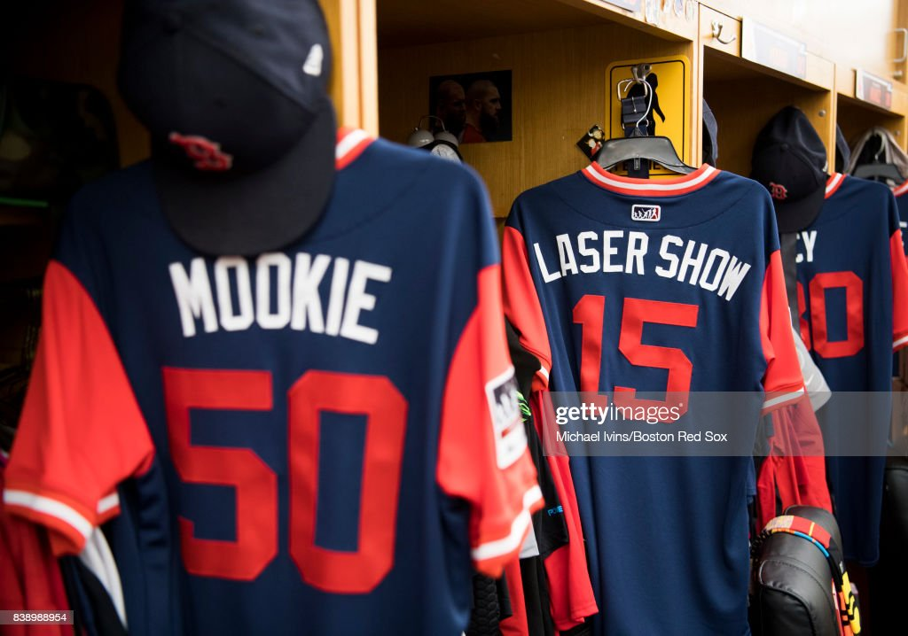 Jersey's bearing the nicknames of Mookie Betts #50 and Dustin Pedroia #15 of the Boston Red Sox hang in the clubhouse before a players weekend game against the Baltimore Orioles at Fenway Park on August 25, 2017 in Boston, Massachusetts.