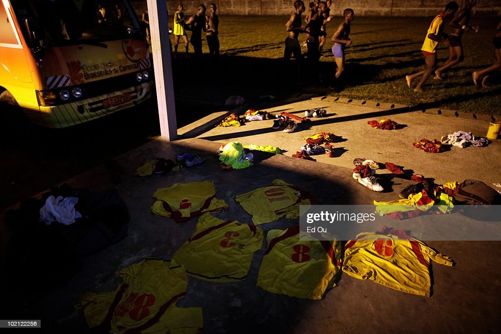 Jerseys from athletes in the l'�cole de soccer des Brasseries Cameroun are strewn on the ground as they run laps, May 26, 2010 in Douala, Cameroon. The students in the soccer academy spend their days training and studying.