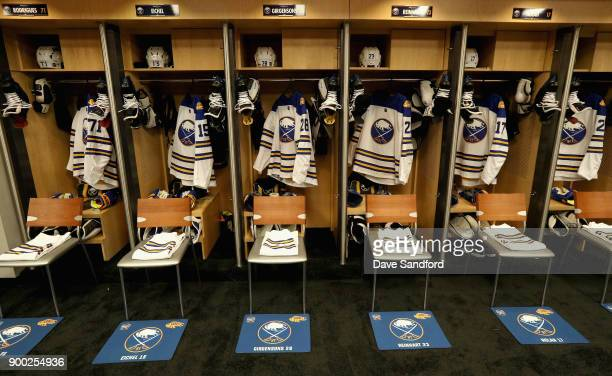 Jerseys hang in the Buffalo Sabres locker room before the start of the 2018 Bridgestone NHL Winter Classic between the New York Rangers and the...
