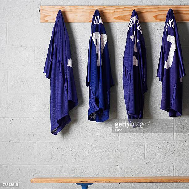 jerseys hanging on a wall - sports jersey stock pictures, royalty-free photos & images