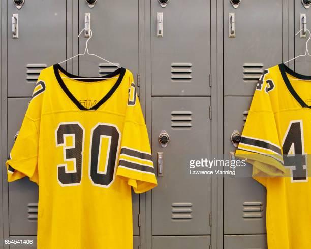 jerseys hanging on lockers - trikot stock-fotos und bilder
