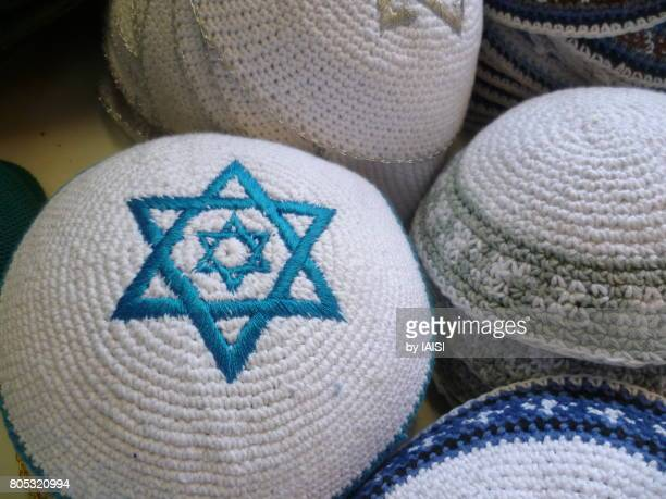 Jerusalem, blue and white kipas, close-up of star within a star