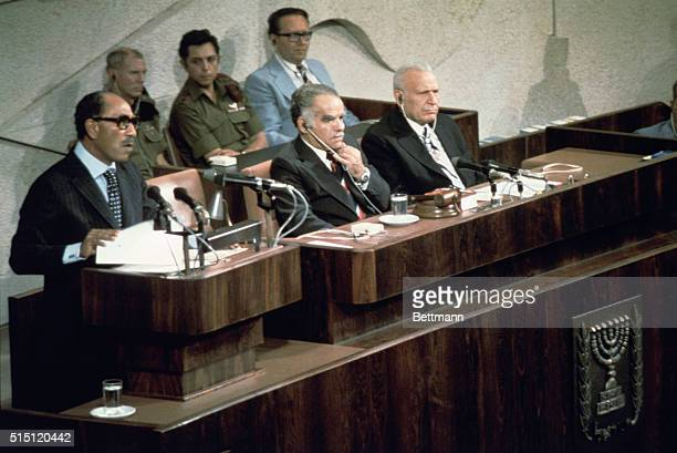 Egypt's President Anwar Sadat speaks to the Israeli parliament To his left are parliament speaker Yitzhak Shamir and President Ephraim Katzir