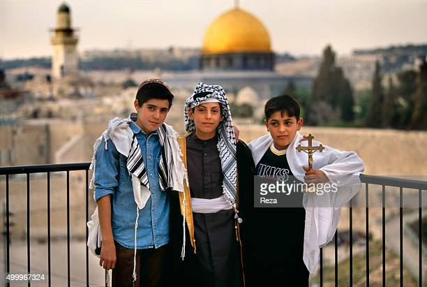 2000 Jerusalem Israel Reza brought together three children one Jewish one Muslim and one Christian all bearing the name of Abraham at the Dome of the...