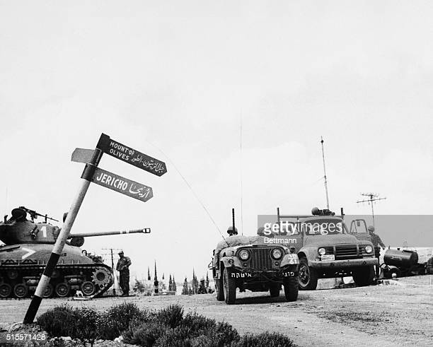 Israeli mechanized units move through a crossroad in Jerusalem June 7th past a signpost pointing the way to the biblical city of Jericho Israeli...