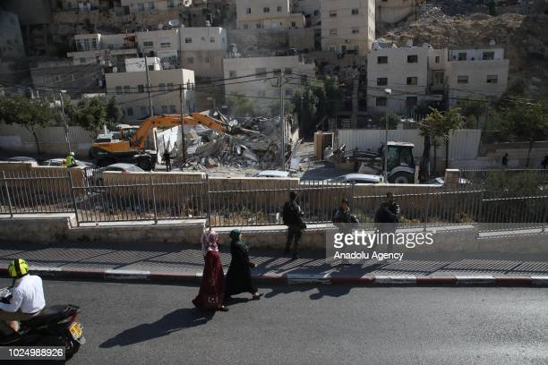 Jerusalem municipality team belonging to Israel demolish a trading area operated as a printing house by Palestinians with the claim of being...