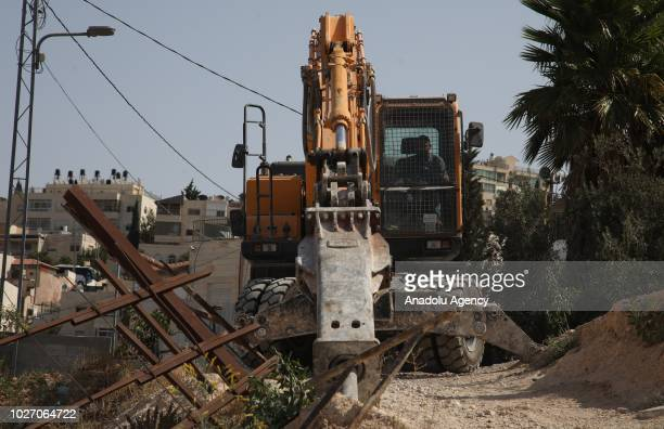 Jerusalem municipality's demolition team belonging to Israel, demolishes a house of Palestinians with the claim of being unlicensed in Ras al-Amud...