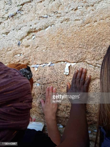 jerusalem, praying at the western wall, the women's side - judaism stock pictures, royalty-free photos & images
