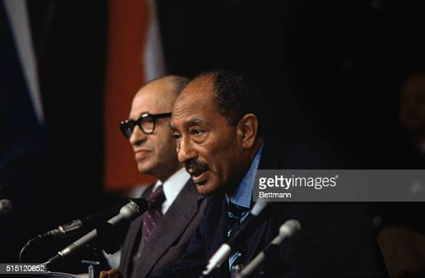 President Anwar Sadat of Egypt as he concentrates on a newsman's question during a joint news conference with Israeli Prime Minister Menahem Begin...
