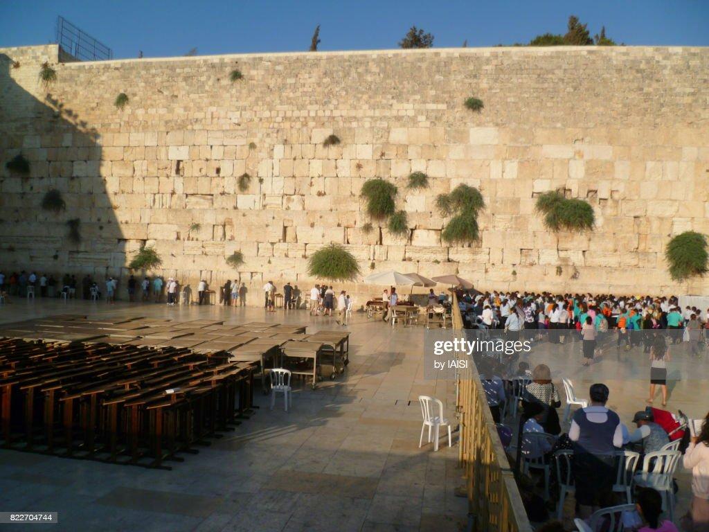 Jerusalem, the Western Wall, dusk at the mens' side on the left, the womens' side on the right : Stock Photo