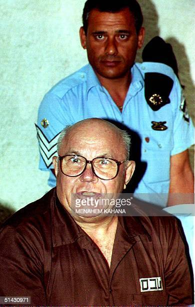 Convicted Nazi war criminal John Demjanjuk hears Israel's Supreme Court in Jerusalem 29 July 1993 read his acquittal more than five years after he...