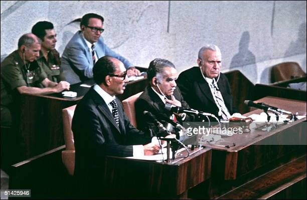 Egyptian President Anwar alSadat addresses 20 November 1977 in Jerusalem the Knesset during his historic visit to Israel as Israeli Premier Yitzhak...