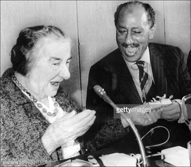 File picture dated 21 November 1977 of Israel former Prime Minister Golda Meir exchanging present with Egyptian President Anwar EL Sadat during a...