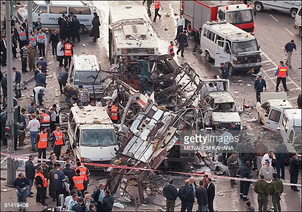 Israeli rescue teams looking for victims inside the wreckage of the bus which was destroyed 25 February 1996 by a bomb explosion in Jerusalem At...