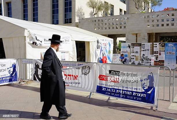 Jerusalemite passes by the Remembrance Tent displayed to honor the memory of Prime Minister Yitzhak Rabin who was assassinated on November 5th, 1995.