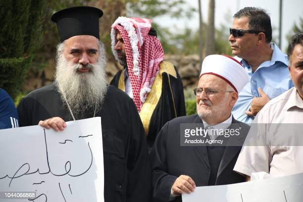 Jerusalem's Greek Orthodox Archbishop Atallah Hanna and Imam of AlAqsa Mosque Ikrimah Sabri attend a protest against United Nations Relief and Works...