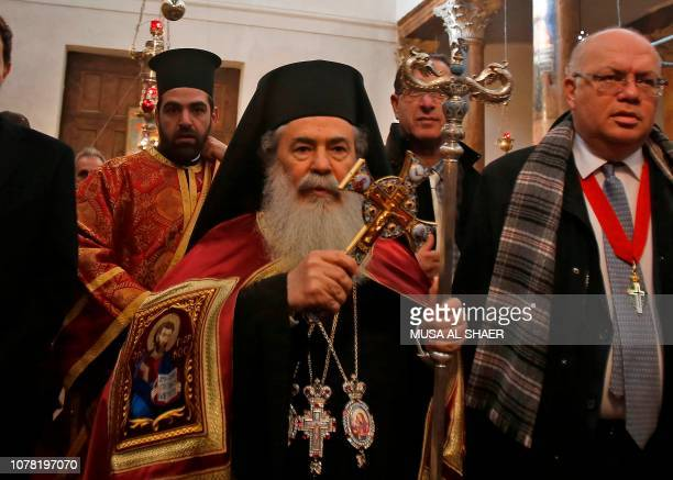 Jerusalem's Greek Orthodox Patriarch Theophilos III arrives at the Church of the Nativity in the occupied West Bank town of Bethlehem to celebrate...