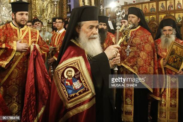 Jerusalem's Greek Orthodox patriarch Theophilos III attends a Christmas service according to the Eastern Orthodox calendar in the church of Nativity...