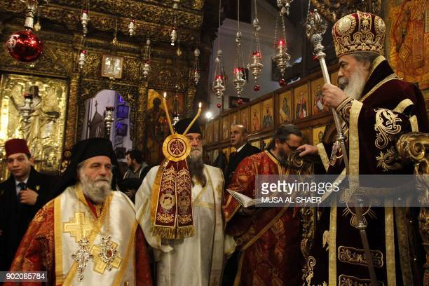 Jerusalem's Greek Orthodox patriarch Theophilos III leads the Christmas Midnight Mass for the Greek Orthodox at the Church of the Nativity in the...