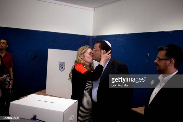 Jerusalem's municipal elections religious candidate Moshe Leon gets a kiss from his wife after he casts his vote for the municipality elections at a...