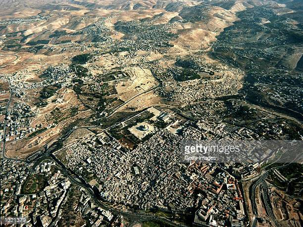 Jerusalem''s Old City and the Arab neighborhoods of East Jerusalem stretch into the Judean Desert December 15, 2000 with the distinctive golden Dome...