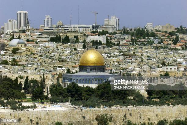 View taken 20 July 2000 of Jerusalem's Old City with the Dome of the Rock and alAqsa mosques and the modern Israeli western part of the city in the...
