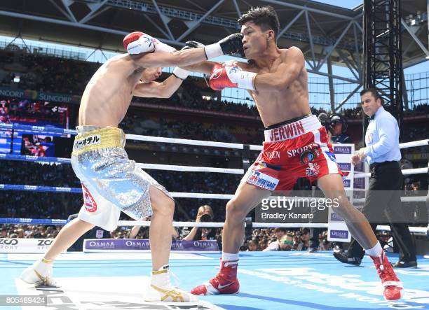 Jerwin Ancajas of the Philippines fights Teiru Kinoshita of Japan during their IBF World Junior Bantamweight Title fight at Suncorp Stadium on July 2...