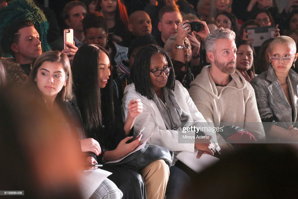 Jerzy Dean, Whoopi Goldberg, and a guest attend the Ceremony: Xuly.Bet x Mimi Prober x Hogan McLaughlin front row during New York Fashion Week presented by First Stage at Industria Studios on February 8, 2018 in New York City.