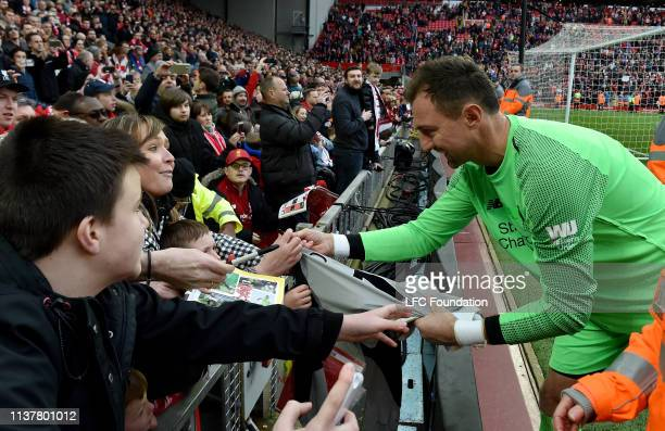 Jerzy Dudek of Liverpool FC Legends showing his appreciation to the fans at the end of the friendly match between Liverpool FC Legends and AC Milan...