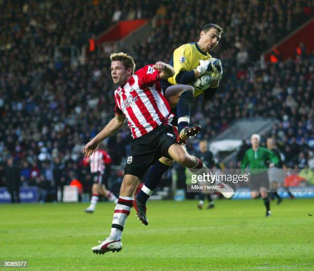 Jerzy Dudek of Liverpool jumps higher than James Beattie of Southampton during the FA Barclaycard Premiership match between Southampton and Liverpool...