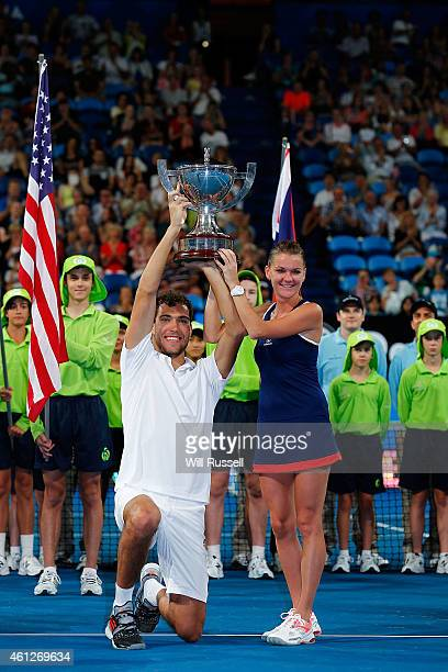 Jerzy Janowicz and Agnieszka Radwanska of Poland lift The Hopman Cup after defeating John Isner and Serena Williams of the United States in the mixed...