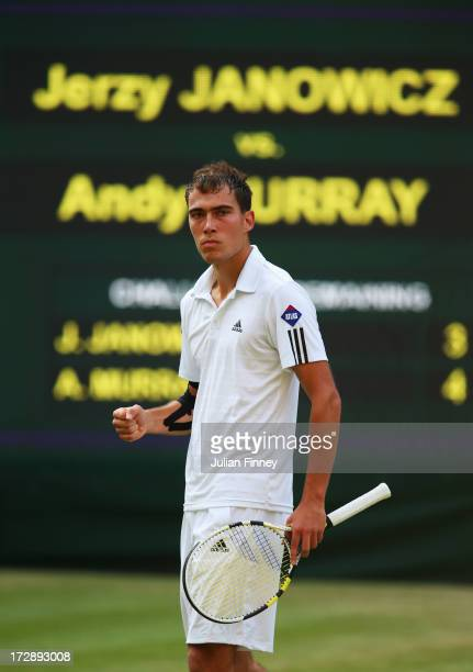 Jerzy Janowicz of Poland celebrates the first set point during the Gentlemen's Singles semi-final match against Andy Murray of Great Britain on day...