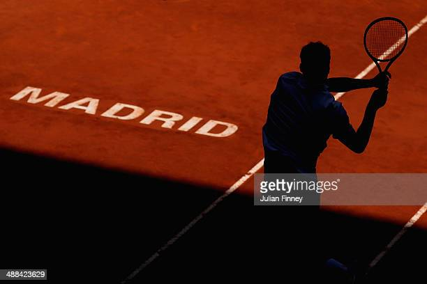 Jerzy Janowicz of Poland in action against Ernests Gulbis of Latvia during day four of the Mutua Madrid Open tennis tournament at the Caja Magica on...