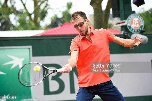 Jerzy Janowicz of Poland in action in his win against Maxime Hamou of France at the French Open Roland Garros Stadium on May 26 2015 in Paris France