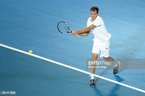 Jerzy Janowicz of Poland plays a backhand shot in his first round match against Nick Kyrgios of Australia during day three of the Sydney...