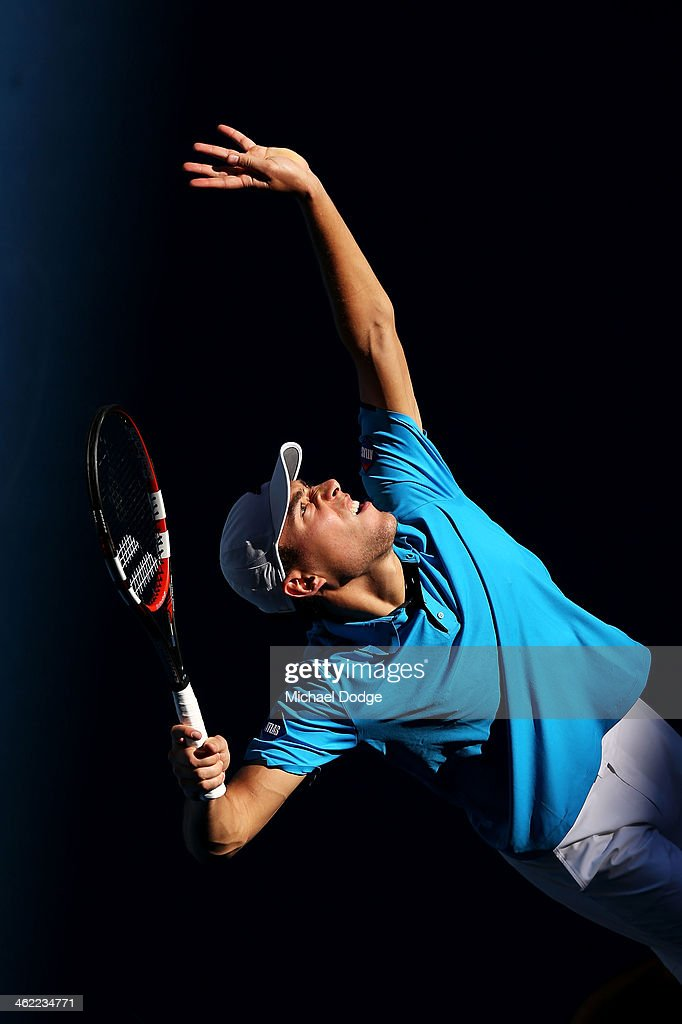 Jerzy Janowicz of Poland serves in his first round match against Jordan Thompson of Australia during day one of the 2014 Australian Open at Melbourne Park on January 13, 2014 in Melbourne, Australia.