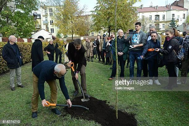 Jerzy Kornhold and Jakub Kornhauser attend the ceremony of planting Wislawa Szymborskaâs acacia on October 24 2016 near Dworek Lowczego in Krakow...