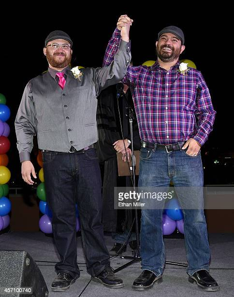 Jes Cumpian and Halley Clark both of Nevada react after getting married at Las Vegas PRIDE's National Coming Out Day festival at the Alexis Park All...