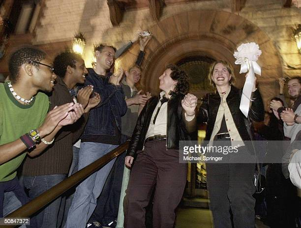 Jes Shuford and Shannon Andrews celebrate their aplication for a marriage licence in the early hours of May 17 2004 in Cambridge Massachusetts...