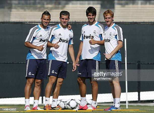 Jese Nacho Fernandez Alvaro Morata and Alex Fernandez of Real Madrid pose during a training session at UCLA Campus on August 1 2012 in Westwood...