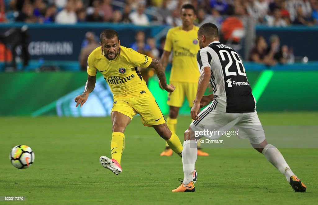 Jese #22 of Paris Saint-Germain passes past Tomas Rincon #28 of Juventus during the International Champions Cup 2017 match at Hard Rock Stadium on July 26, 2017 in Miami Gardens, Florida.