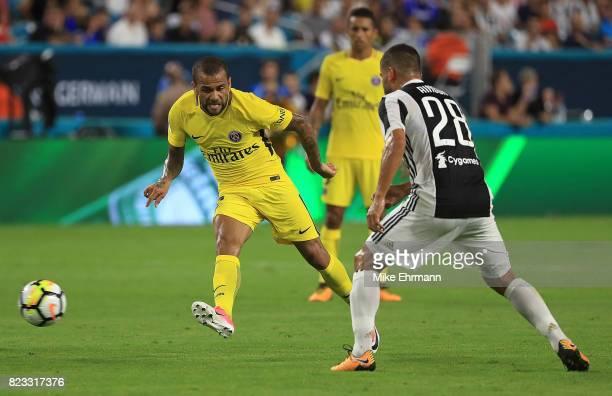 Jese of Paris SaintGermain passes past Tomas Rincon of Juventus during the International Champions Cup 2017 match at Hard Rock Stadium on July 26...