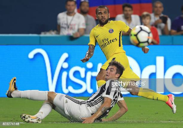 Jese of Paris SaintGermain shoots on Andrea Barzagli of Juventus during the International Champions Cup 2017 match at Hard Rock Stadium on July 26...