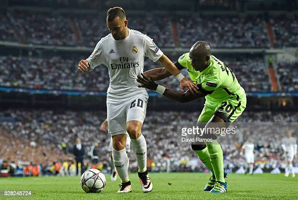 Jese of Real Madrid is challenged by Eliaquim Mangala of Manchester City during the UEFA Champions League semi final second leg match between Real...