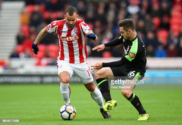 Jese of Stoke City and Lewis Cook of AFC Bournemouth in action during the Premier League match between Stoke City and AFC Bournemouth at Bet365...