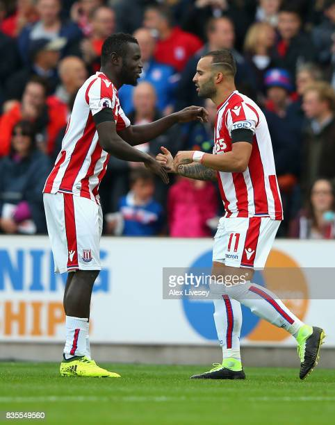 Jese of Stoke City celebrates scoring his sides first goal with Mame Biram Diouf of Stoke City during the Premier League match between Stoke City and...
