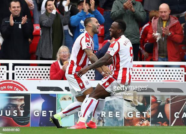 Jese of Stoke City celebrates scoring his sides first goal with Saido Berahino of Stoke City during the Premier League match between Stoke City and...