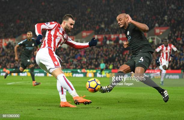 Jese of Stoke City is faced by Vincent Kompany of Manchester City during the Premier League match between Stoke City and Manchester City at Bet365...