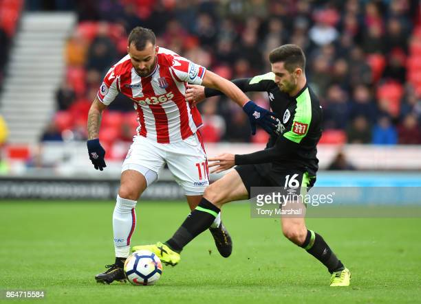 Jese of Stoke City is tackled by Lewis Cook of AFC Bournemouth during the Premier League match between Stoke City and AFC Bournemouth at Bet365...