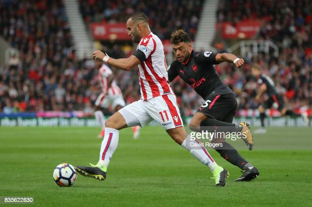 Jese of Stoke City run with the ball during the Premier League match between Stoke City and Arsenal at Bet365 Stadium on August 19 2017 in Stoke on...